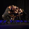 Foto do palco do Teatro Polytheama, com grupo em performance de dança